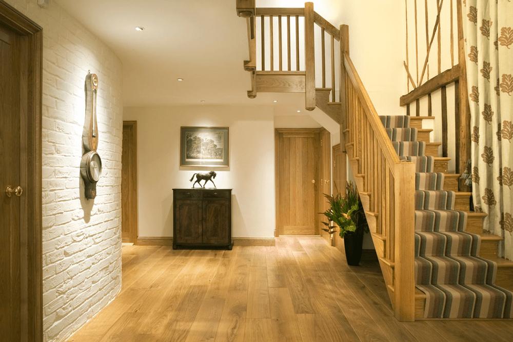 Character Grade engineered Oak over underfloor heating with complementary doors and joinery.